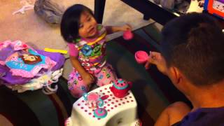 Cute Asian toddler having tea party with daddy