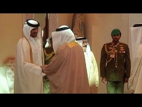 Qatar Sheik hands power to son