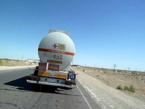 Slipstreaming behind an oil truck in the Kyzylkum desert, Uzbekistan