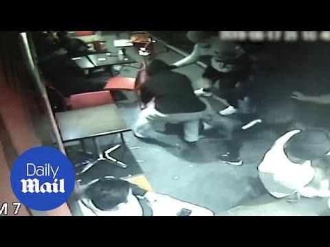 Confronting Moment Group Of Men Smoking Shisha Abrawl In A Café