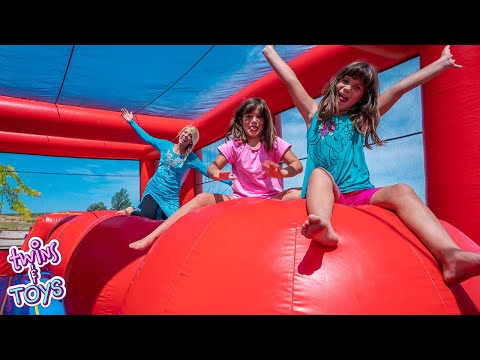 Elsa Surprises Kate and Lilly with a GIANT Inflatable Bounce House