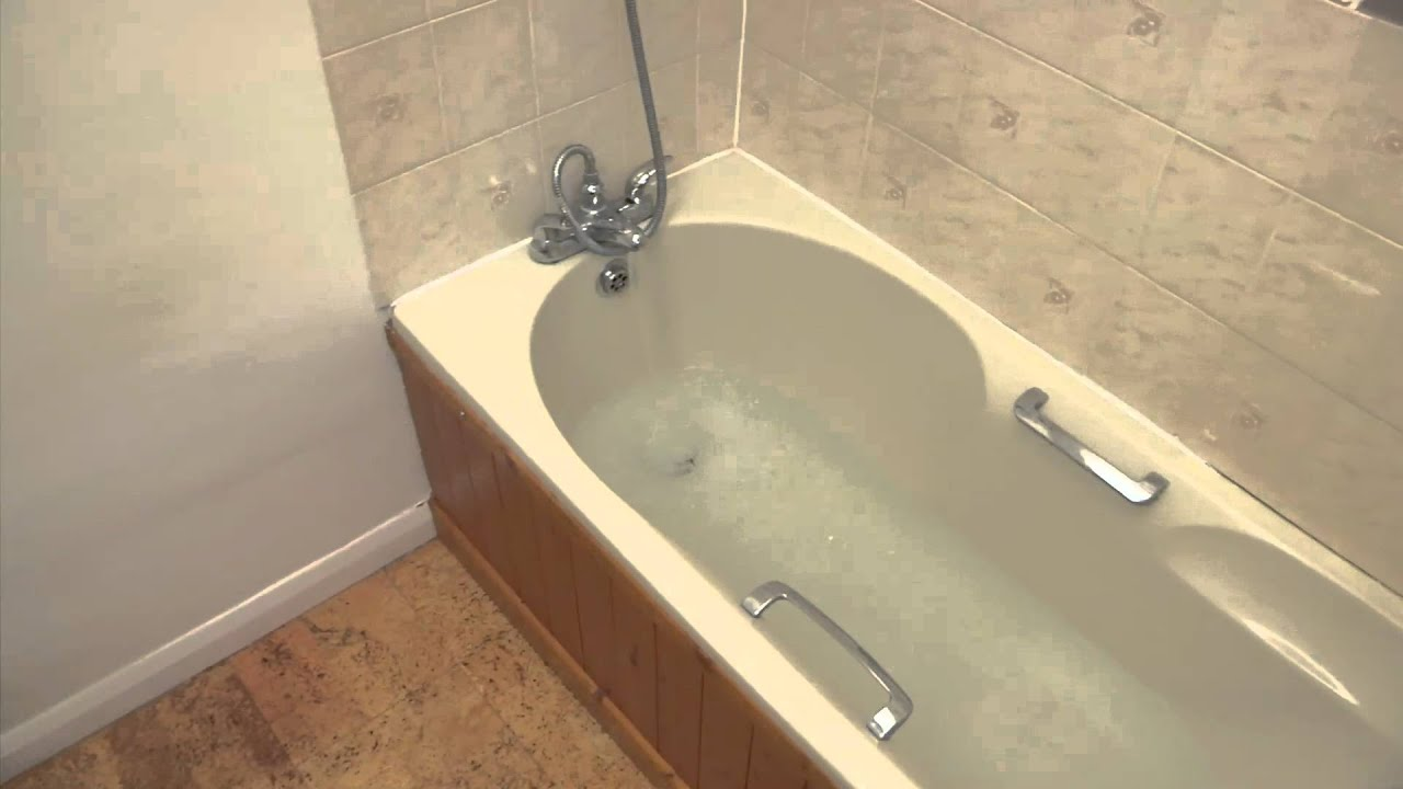 How To Replace Sealant Around Your Bath - YouTube