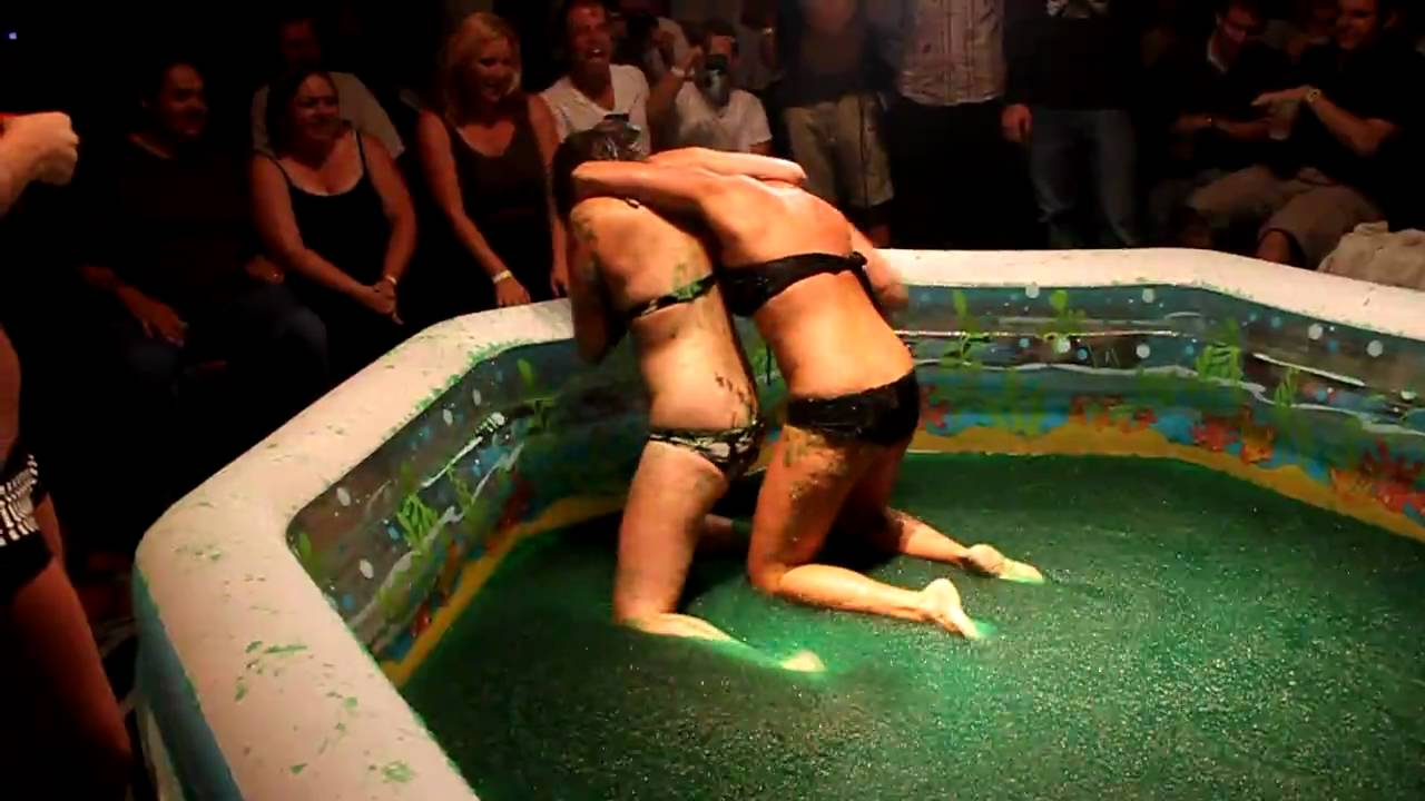 You Girls wreatling in pool