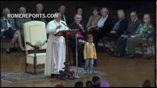 Video of boy who distracts Pope during Vigil, breaks records thumbnail