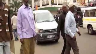 Nairobi: 'Jaywalkers & Matatus' Downtown CBD, Kenya Africa © 2009 Wm Kai Stephanos unit45Ⓧ