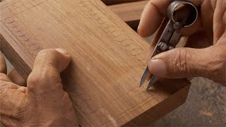 Tarkashi - Craftsman creating the design on a piece of wood with calipers compass