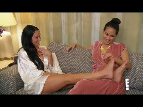 Nikki Bella puts her Barefeet on Brie.