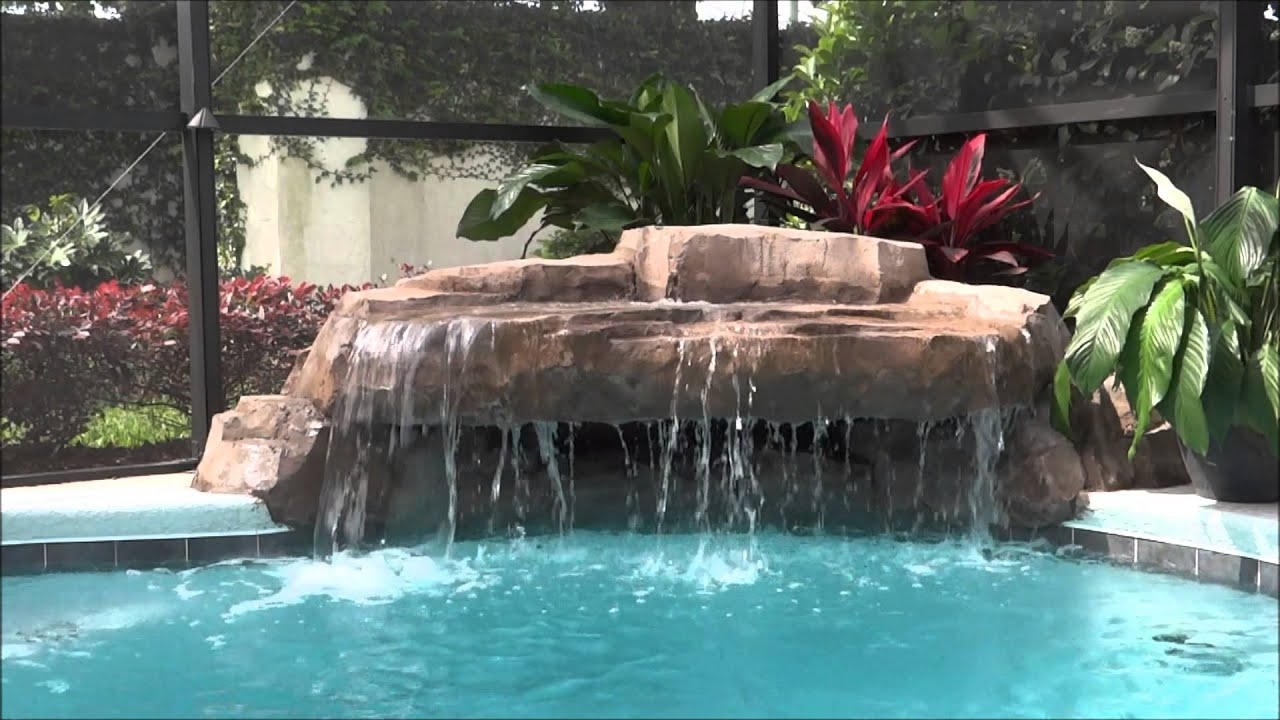 Small grotto pool waterfall swimming pool rock watefall - How to build a swimming pool slide ...