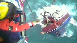 UK coast guard rescues five people from sinking boat in dramatic video