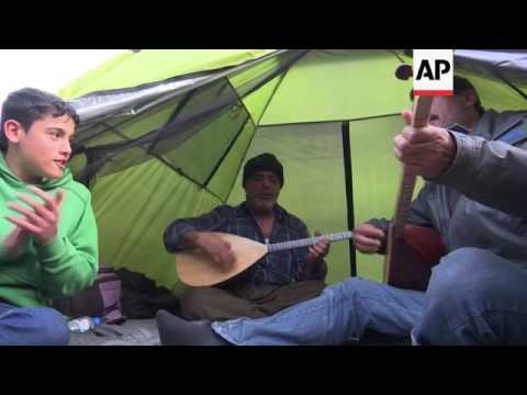 Kurdish musicians play at Macedonia border