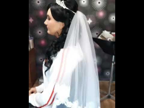 Образ невесты. Причёска с длинной фатой и макияж.