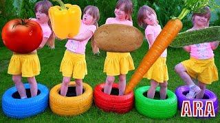 فتاة مع أغنية تتعلم أسماء الخضروات