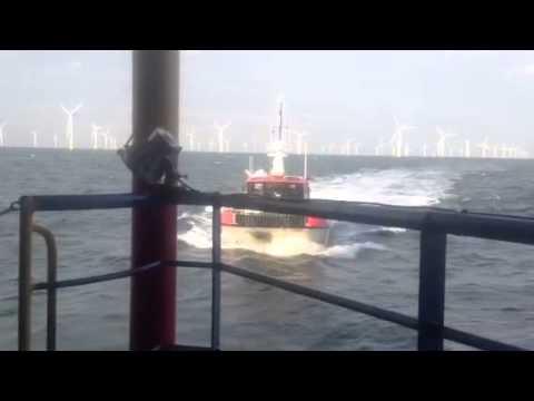 Wind farm boat coming into hotel ship