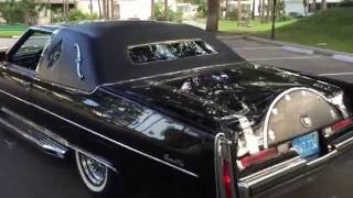 Custom 1975 Cadillac Coupe DeVille by Universal Coach. Painted in Cadillac ' Sable Black'.