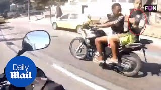 Biker cam captures terrifying moment he is hijacked and SHOT - Daily Mail