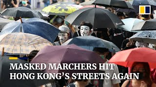 Thousands of masked marchers take to Hong Kong's streets protesting the government's emergency law