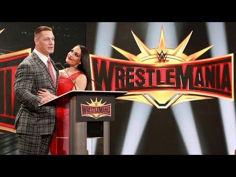 John Cena shares a kiss with Nikki Bella during WrestleMania 35 press conference