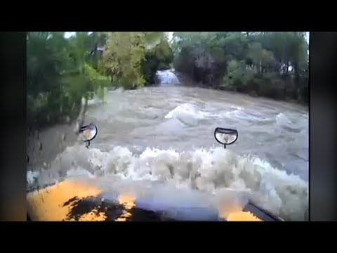Dashcam: Texas school bus swept away by floodwaters