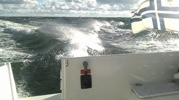 23 - 31 knot winds. 6 - 9 foot waves. Beneteau Antares 8S.