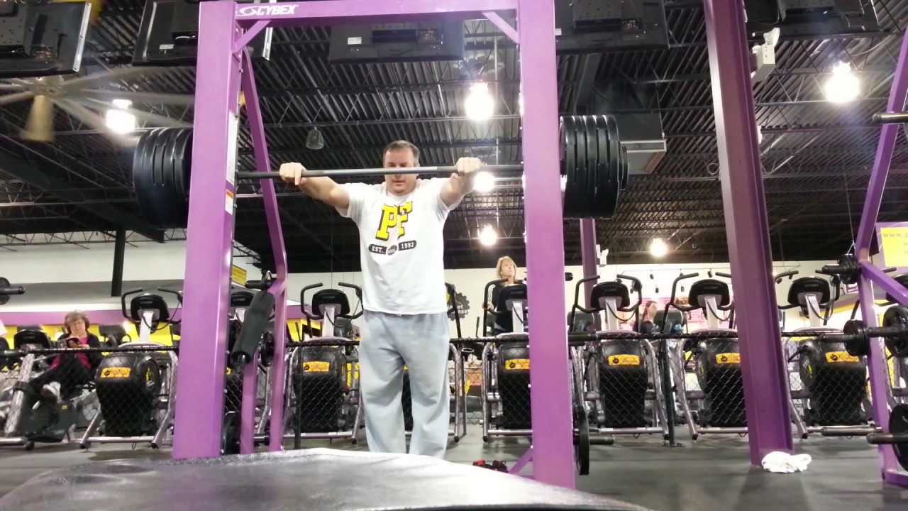 planet fitness smith machine bar weight