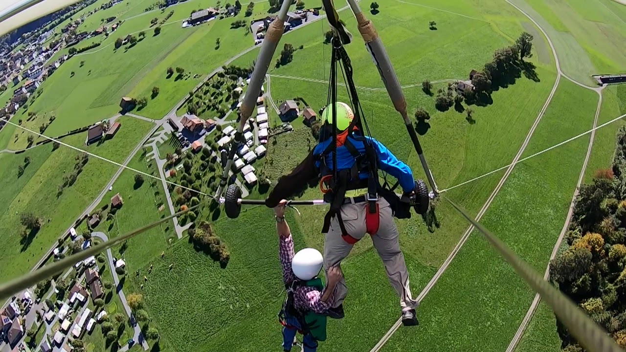 Man dangles off hang-glider for over 2 minutes after pilot fails to