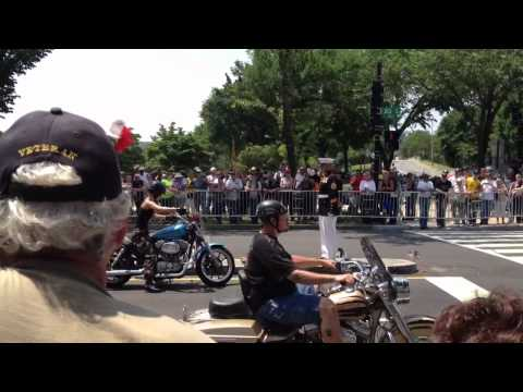 A female Army Soldier stops her bike during Rolling Thunder XXV t