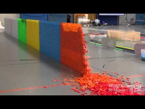 Thumbnail: 128,000 Dominoes Falling into past a journey around the world 2 Guinness World Records) YouTub
