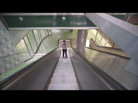 Sweden, Stockholm, Liljeholmen subway station, 2X escalator