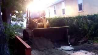 CAT 963d Track Loader Excavating Asphalt Alley