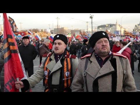 Putin joins celebration marking takeover of Crimea