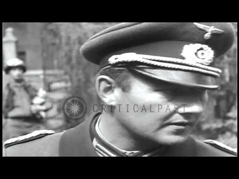 German and US officers at surrender proceedings in a town square in Regensburg, G...HD Stock Footage