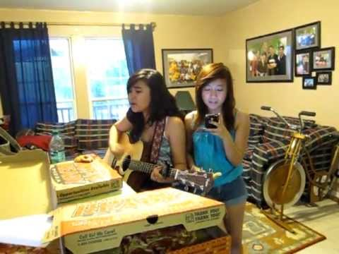 Two girls, a pizza and a guitar