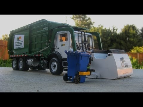 First Gear Front Load Garbage Truck Mounted With A Curo