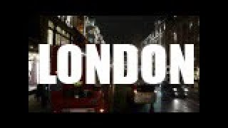 Bus driving on streets of  London at night HQ