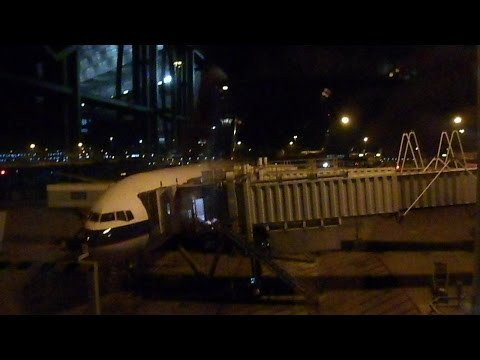 Cathay Pacific Flight CX715 From Hong Kong to Singapore on the Boeing 777-367 ( Economy Class )