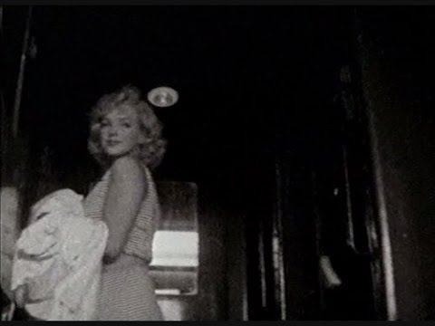 Marilyn Monroe And Arthur Miller -   At Train Station Back To New York  May 1957