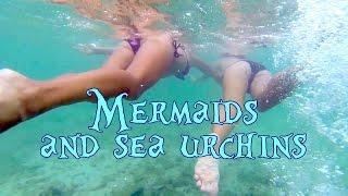 Mermaids in the sea. Two cute bikini models are swimming in wild sea!