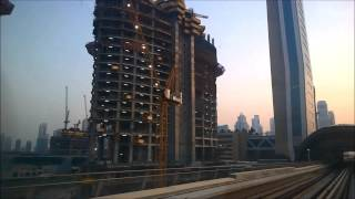 Dubai Metro sunset trip: WTC, Emirates Towers, Burj Khalifa,,,