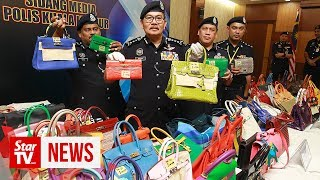 Cops nab four suspected robbers, recover 81 Hermes handbags worth RM6mil