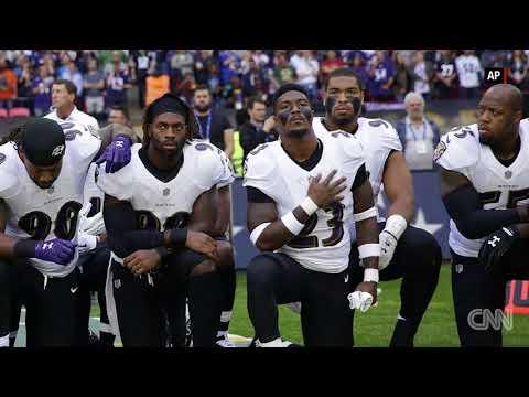 Ravens, Jaguars players kneel during national anthem