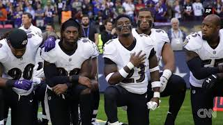Ravens Jaguars players kneel during national anthe