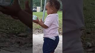 Baby messing with trash