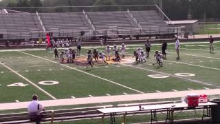 Kameron Hazelette, #50, in his first 2015 Pop Warner game playing offense thumbnail