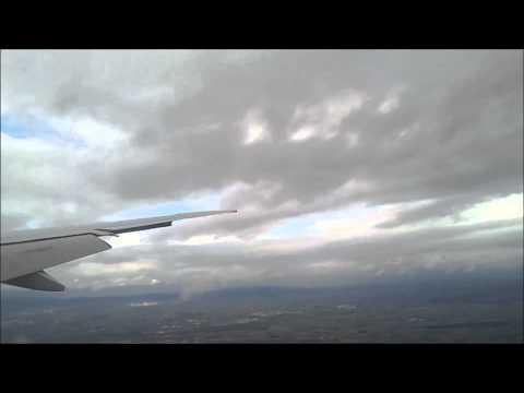 Emirates 777-300ER landing in Frankfurt during turbulent weather (HD)