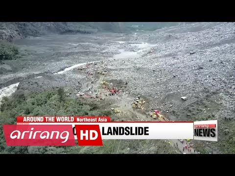 Nearly 100 missing as search continues in China landslide