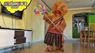 GINGERBREAD WARRIOR and his Giant Lollipop! Skyheart dinosaur toys battle candies sharks kids