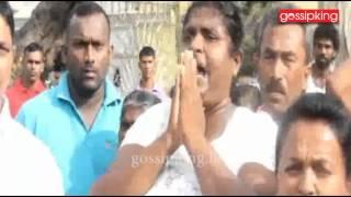 Traders at Kataragama break coconut against media reporters [www.gossipking.lk]
