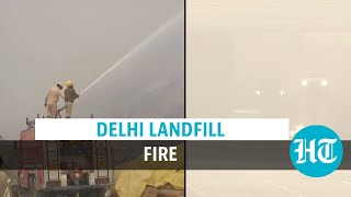 Delhi landfill fire rages for over 12 hours as pollution drives Covid spike