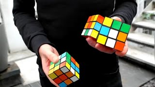 Жонглируя собрал три кубика Рубика