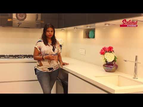 lacquered-glass-finish-'l'-shape-modular-kitchen-by-solana-kitchens